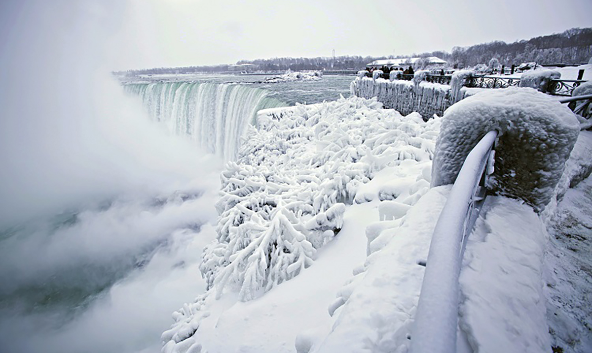 Winter Temperatures Reach A New Level Of Low As Niagara Falls Freezes Into Something Out of Narnia