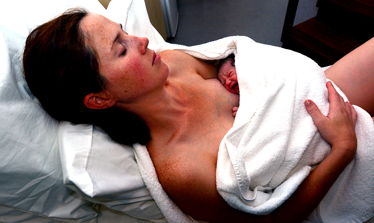 People Everywhere Are Touched By This Photograph Of A Woman Moments After Birthing Her Son